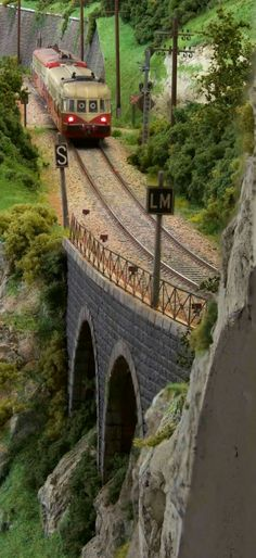 Beautifully detailed European OO Scale Layout,  with a train being pulled by a Toaster!