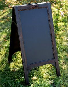 I want this anyway so the baby shower is a perfect reason to purchase it!  - Black Boards Large Wood Framed Standing Chalkboard Easels (two sided) $29