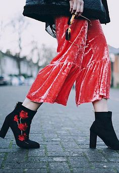 Yes, even in 2017 we're still not sick of the fabric du jour. Swap out your regs trousers for velvet ones with a flared hem and pair with a black roll neck and aviator jacket. Keep the red theme running strong and add cutesy rose-printed ankle boots.