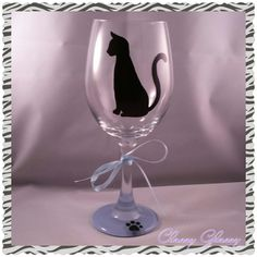 This kitty cat wine glass is perfect for all cat lovers!  Hand painted with a black silhouette cat and an adorable kitty paw print on the stem with a blue bottom.  You may choose a different color bottom. ~~20 oz large high quality wine glass. All glassware is hand painted by me with special paint made for glass and oven cured.  Hand washing is recommended for long lasting beauty. $14.95 #Kitty #Cat  #HandPainted #WineGlass