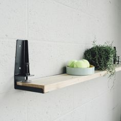 "The Floyd Shelf is a tool that allows you create a Shelf from any flat  surface by installing the brackets & clamping to the material.       * Quantity of 1 set contains a left and right shelf bracket to create 1       shelf.     * Comes with (4) stainless steel phillips head screws for installation.     * Available in white, black, or red powder coat finish.     * Works with materials up to 1 5/8"" (4 cm) thick     * Shelf bracket is 5 1/2"" (15.25 cm) deep.      * Vertical lip of bracket…"