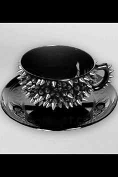 for those rebellious days....Spiked Teacup, coffee cup, black