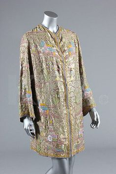 A fine embroidered and beaded chinoiserie jacket, attributed to Margaine Lacroix, circa 1925, of gold lamé adorned with pagodas and figures carrying parasols in mainly pink, blue and yellow beads and sequins with finely chain-stitched silk details