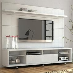 Maximize your living room space with the Cabrini TV Panel. With a built-in TV mount to easily hang your TV without damaging the walls, the Cabrini TV Panel is lightweight and compact, and will Tv Stand And Panel, Wall Tv Stand, Tv Panel, Tv Cabinet Design, Tv Wall Design, Tv Unit Design, Tv Wanddekor, Modern Tv Wall Units, Modern Tv Cabinet