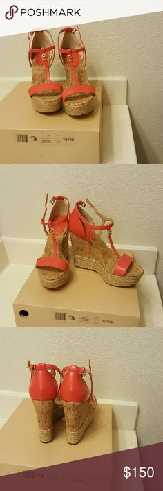 MICHAEL KORS WATERMELON KERRI WEDGE SANDAL ??AUTHENTIC.  New  Never Been Worn  Achieve a trendy style with these towering wedge sandals!Leather watermelon color Adjustable heel strap with a buckle closure.Single vamp strap.T-strap boasts logo detail.Leather lining.Lightly padded insole.Wedge heel.Rubber outsole.Imported. Measurements:Heel Height: 4.5in Platform height: 1.5 in.  Comes with box without top Size: 7m Michael Kors Shoes Wedges
