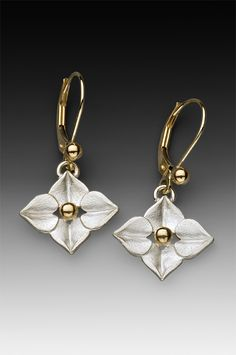 sterling and gold floral dangle earrings - small How much is this one... I want it [:O). See more on my new jewelry release site.