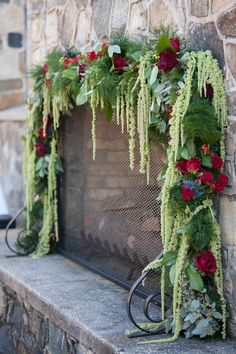 Greenery, eucalyptus and red roses! Such romantic fireplace decor for a fall or winter wedding. {Dianne Personett Photography}
