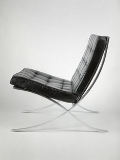 The famous Mies van der Rohe Barcelona chair.  First created for the German Pavilion at the 1929 Barcelona Exposition.  Have two replicas in my office.