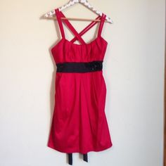 Red and Black Dress Size: Junior's Size 7 Brand: Jodi Kristopher Fit: True to size Sleeves: Sleeveless double spaghetti straps. Material: Self and contrast: 56% polyester, 41% cotton, 3% spandex. Lining 100% polyester. Color: Red and Black Purchased at: Sears Other details: It has double criss cross straps. Black band ties in the back. Beaded and sequin flowers. Pockets. Pleated. Slimming. Padded bust. Zips up in the back.  Condition: Pre-loved. No noteworthy flaws. MSRP $84.00 Jodi…