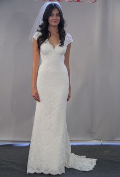 Brides: Watters - Fall 2012 :  her boobs look good in this dress, i like that they don't blend in to the waist as much