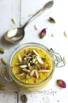 Persian Saffron Rice Pudding (Sholeh-Zard) {Middle Eastern recipes} Flavored with saffron and rose water, decorated with cinnamom, almonds and pistachios, you will experience an exotic dessert from another place and time. Iranian Desserts, Persian Desserts, Iranian Dishes, Iranian Cuisine, Turkish Recipes, Indian Food Recipes, Ethnic Recipes, Persian Recipes, Saffron Recipes