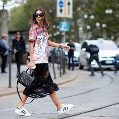 Dress down a sexy sheer midi-skirt by throwing on an oversize t-shirt and a pair of classic sporty green Adidas.