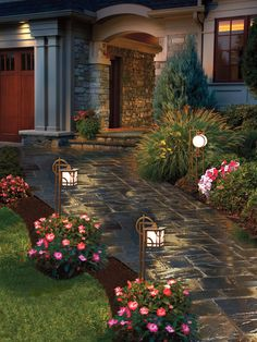 """Using different styles of path lights in the same scheme can help you avoid the """"good little soldier"""" look. Be sure to clean the lamp surfaces and check for burned-out bulbs at least once a year, and relocate the stakes if plant growth has blocked their light output."""