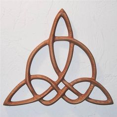Triquetra of Harmony-Celtic Wood Carved Knot MEANING: When you are struggling to find balance with different aspects of your life, this symbol may call to you Possible tattoo? Mind, Body Spirit all in harmony? Celtic Patterns, Celtic Designs, Courage Tattoos, Celtic Goddess, Symbols Of Strength, Inner Strength, Celtic Art, Irish Celtic Symbols, Mayan Symbols