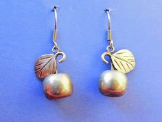 SoVintageous is offering these adorable vintage sterling silver drop earrings, handmade in Taxco, Mexico.  The detailing is fabulous and wonderfully lifelike with the hollow silver apples dangling fro