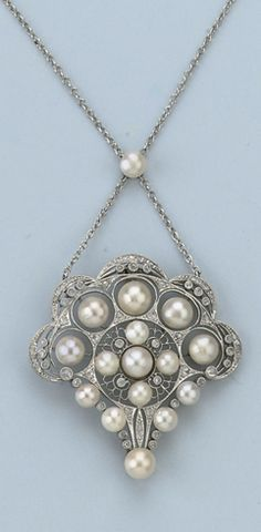A BELLE EPOQUE NATURAL PEARL AND DIAMOND NECKLACE The openwork fan-shaped pendant set with graduated natural pearls and diamonds to a fine chain, circa 1910