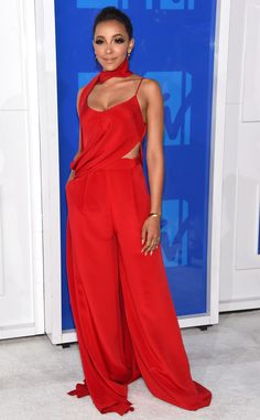 """Tinashe from MTV Video Music Awards 2016 Red Carpet Arrivals  The """"Player"""" singer looks red-hot in a draped scarlet jumpsuit."""