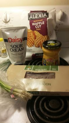 I began with the ingredients.  One full bag of Alexia waffle fries, one bunch scallions, 8 slices of bacon, some squeezable Daisy sour cream ( my new favorite ) and a jar of pace medium questions dip.