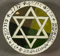 Golden Dawn Earth Pentacle crafted by William Butler Yeats. His motto, Demon est Deus Inversus (the Devil is God inverted), can be seen along the edge.