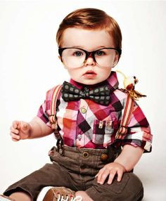 Most adorable baby I've seen a day in my life. Bow tie, suspenders the glasses, the bird, checked shirt. So cute