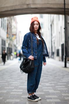 Homies beanie, Levi's jacket, vintage dungarees from Rokit, DKNY crop top, and Zadig & Voltaire bag