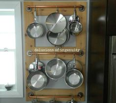s 10 kitchen storage spots you ve been ignoring, kitchen design, storage ideas, Put your pots up on a wall rack
