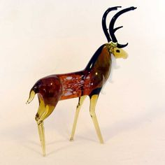 Reindeer Glass Figurine was hand made in lampwoking (glass-working) technique by Russian artist in the art studio of St. The glass figurine was made of glass of different colors.