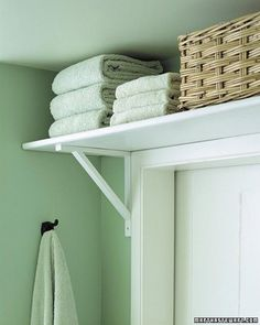 Put a shelf above your bathroom door to store bulky items like towels. Very good idea for those horrible bathrooms with no closet or cabinets. It should be against the law to build a bathroom without storage!
