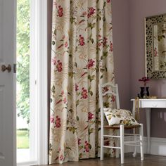 Nothing says luxury quite like a pair of sumptuous curtains at a window. Available in a number of style options, from pinch pleat to pencil pleat, with various additional finishes such as pelmets and tie backs, our range of made to measure curtains offer the ideal bespoke solution to any window. Here in cream colour with flowery pattern