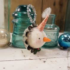 Antique Inspiration Collection 2014.... Embellished with Antique and Vintage Finds.    This Vintage Inspired Snowman is hand sculpted and