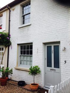 A Charming cottage in Weybridge, Surrey of which we installed our subtle double glazed timber sash windows and a new front door and frame, Sash Window Services Ascot Ltd
