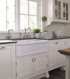 "Divided Farmhouse Sink - Never thought I'd care about kitchen sinks, but then I grew up.  Do like the look of this one in a ""modern cottage"" kitchen."