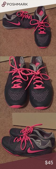 Nike Dual Fusion TR3 Excellent conditions. Pictures depict exact condition. Worn less than 5 times. Deep charcoal gray, light gray polka dots, hot pink accents. Nike Shoes Athletic Shoes