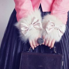 Quick...what's your favorite? fur cuffs, satin bows, filigree ring, monogrammed bag? Decisions, decisions.
