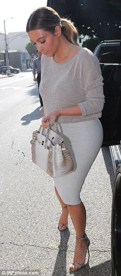 Kim Kardashian shows off her famous derriere in tight skirt for lunch date while Kanye West shows up to a meeting in luxury Lamborghini | Mail Online