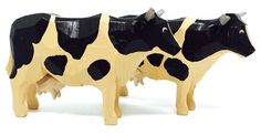 """A hand-carved pair of Black and White Cows, 2-1/4"""" tall. Wood-turned, hand-carved, hand-painted. From Christian Werner's Size Large Noah's Ark - buy One (1 x1) or the Pair (2 x 2). Enjoy the classic folk art of ring-turning - Reifendrehen - since the 1800s   FIND at My Growing Traditions"""