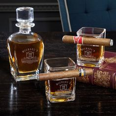 Whiskey is a refined spirit that is best enjoyed with a cigar. Upgrade your favorite way to unwind with our handsomely engraved whiskey decanter set! This three piece set is unlike any other decanter set you've ever seen. The two whiskey glasses are actua