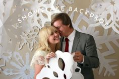 "Big papersnowflakes as photo booth backdrop ""This would be a great, easy and cheap backdrop!""-EH"