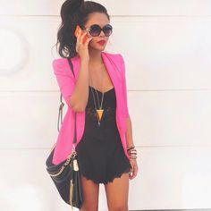 pink blazer over a black romper