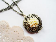 Necklace with a brass locket and ivory flower, vintage style brass, nature jewelry by SelmaDreams on Etsy