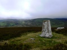 Cold Law trig point in the Cheviot Hills.