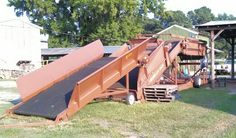 A Granville Equipment box loader, its use to load boxes with tobacco.