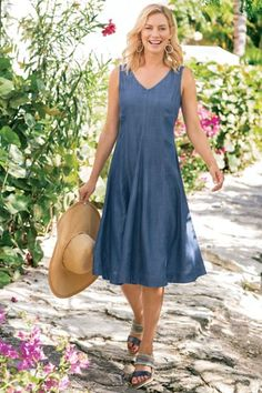 "With its swingy A-line shape in lightweight Tencel®️, this sleeveless dress is fantastically feminine for every day. Delightful details abound, including invisible back zipper with hook-and-eye closure and V-neck in front and back. Tencel®️ lyocell. Misses 43"" long. Take A Twirl Tencel Dress #2AG27"