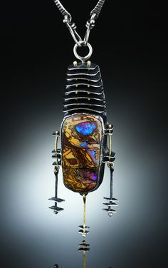 Koroit Opal Centerpiece. Fabricated Sterling Silver and 18k. www.amybuettner.com https://www.facebook.com/pages/Metalsmiths-Amy-Buettner-Tucker-Glasow/101876779907812?ref=hl https://www.etsy.com/people/amybuettner