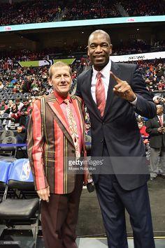 Craig Sager II and former NBA player Dikembe Mutombo attend Boston Celtics vs Atlanta Hawks game