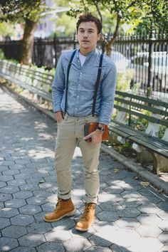 Opt for a light blue denim shirt and khaki chinos for a trendy and easy going look. Dress it up with brown suede boots. Shop this look for $143: http://lookastic.com/men/looks/crew-neck-t-shirt-and-denim-shirt-and-suspenders-and-chinos-and-boots/3780 — White Crew-neck T-shirt — Light Blue Denim Shirt — Navy Suspenders — Khaki Chinos — Brown Suede Boots