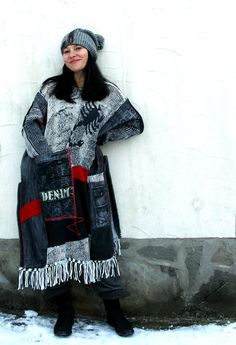 Black denim pop art sweater poncho. Made from recycled sweaters and black denim. Very comfortable and warm. Hippie boho style. Patchwork. Absolutely one of a kind. Size - free: M-XXL Length from tops of the arm - to the lowest point with fringles: about 48 inches (122 cm) Hand wash gently in cold water - pieces of pure wool.