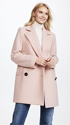 0a290e1e947 Armholes allow this wool Theory peacoat to be worn as a cape or coat.  Notched