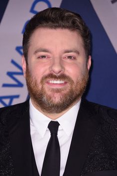 Chris Young Photos - Singer-songwriter Chris Young attends the 51st annual CMA Awards at the Bridgestone Arena on November 8, 2017 in Nashville, Tennessee. - The 51st Annual CMA Awards - Arrivals