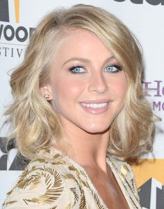 Blonde with waves, side part.